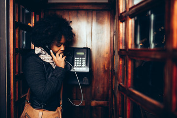Young woman in the telephone booth