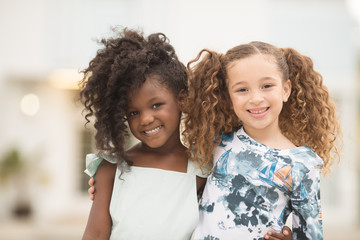 Portrait of smiling girls standing together