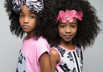 Two girls with curly hair