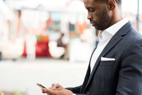 Side view of businessman using smartphone