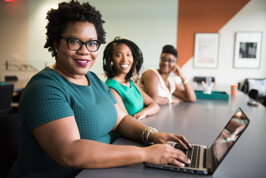 Portrait of smiling businesswomen sitting in the office