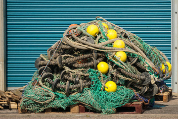 fishing nets and floats on wooden pallet