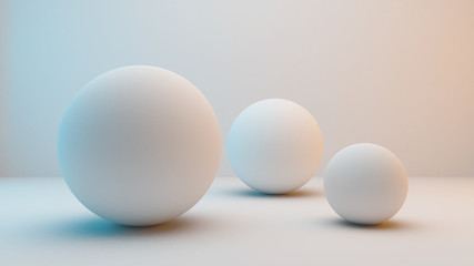 Milky white spheres isolated on white background with slightly blue and orange lighting . 3D Rendering