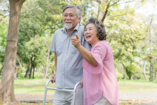 Happy elderly couple with lifestyle after retiree concept. Lovely asian seniors couple walking exercise in the park in the morning.