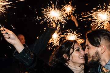 Wedding in the style of rock. Rocker or Biker wedding. Guys with stylish leather jackets. It's a rock'n'roll baby Sweet couple are running with Bengal lights and fireworks in their hands.