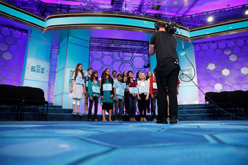 Finalists pose for a group photo between rounds of the Scripps National Spelling Bee at National Harbor