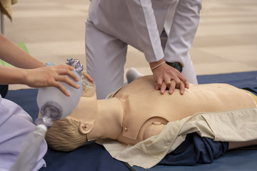 CPR training of chest compression and Ambubag ventilation with a mannequin