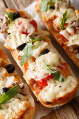 Hot sandwich casserole pizza with chicken, mozzarella cheese, tomatoes and mushrooms close-up. vertical