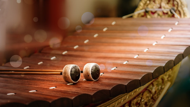 close up of alto xylophone traditional classical Thai and sountheast asia musical instrument made of wood making sound by hit sticks to wood rail