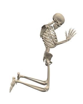 The skeleton kneels and prays.