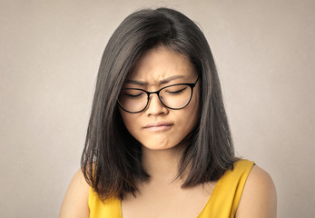 Young chinese girl crying