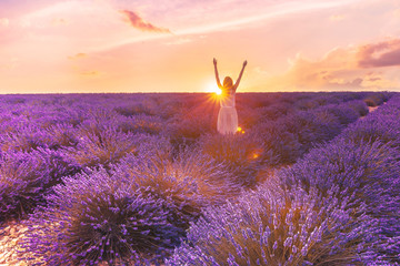 Romantic woman in lavender fields,having vacations in Provence,France. Woman walking in lavender...