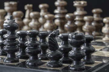 Close Up of a Chess Board and Pieces