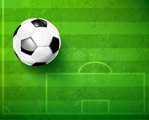 Soccer ball with green glass field
