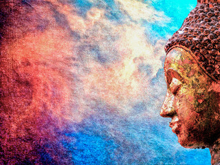 Close up of side face of Buddha statue on abstract colorful background