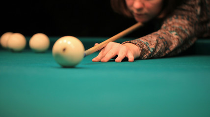 Playing billiard. Billiards balls and cue on green billiards table. Billiard sport concept. Pool billiard game. Russian pyramid (Russian billiard, pyramid billiards), cue sport.