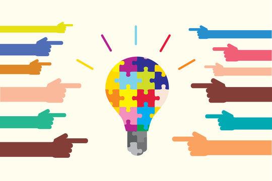 多様性とアイディアを表すカラフルな電球と手 Diversity and creativity shown by puzzle bulb