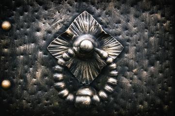 forged metal products, door hammer handle in brown tones