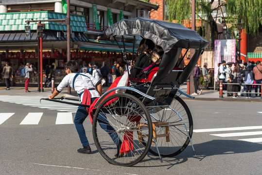 TOKYO, JAPAN - OCTOBER 31, 2017: Rickshaw on the city street. Copy space for text.