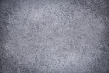 Grey textured concrete wall. Dark edges