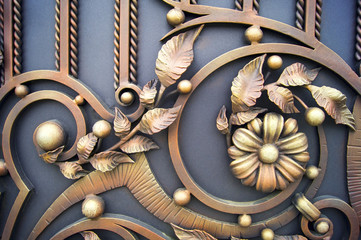 Metal flowers and other forged gates
