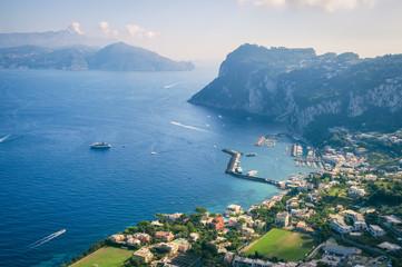 Scenic view of the dramatic coastline of the Mediterranean island of Capri across to the Almalfi coast of mainland Italy