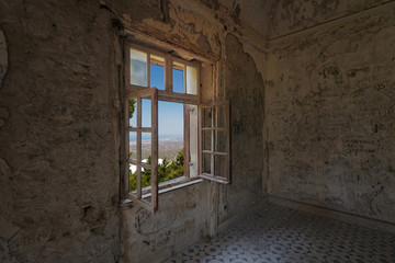 Open window in the abandoned house from inside
