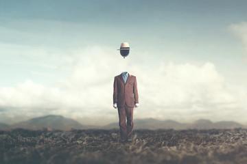 Obraz surreal minimalist man with big black balloon suspended over his head - fototapety do salonu