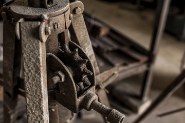 Power hammer shaping metal in blacksmith