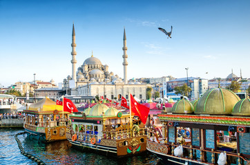 ISTANBUL, TURKEY - October 6, 2015: View of the Suleymaniye Mosque and fishing boats in Eminonu, Istanbul, Turkey Wall mural