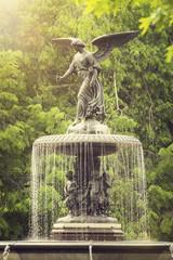 an angel on a fountain