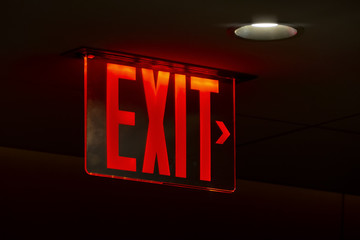 a red lit exit sign