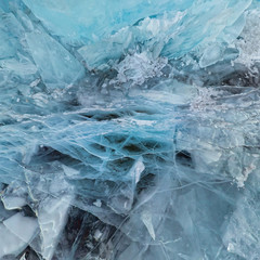 Background ice blue crystal clear lake covered with cracks