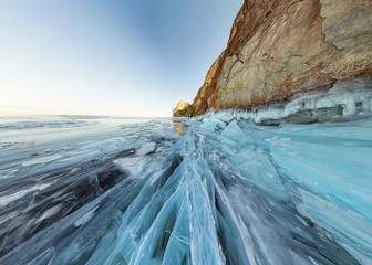 rock in the ice of Lake Baikal, the island of Olkhon. Panorama landscape, abstraction