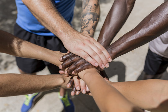 Four Multiethnic Friends Stacking Hands