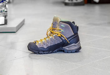 Hiking mountain boots , trekking and hiking equipment footwear for outdoor mountain trails on the floor store