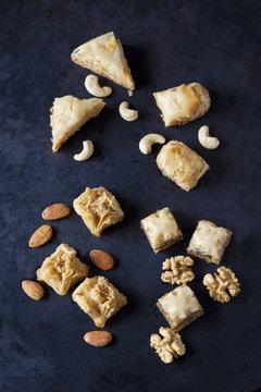 Baklava and nuts on dark ground