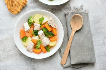 Bowl with soup from vegetable and chicken breast
