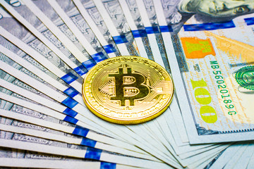 Crypto currency. Coins Bitcoin (BTC), banknotes one hundred dollars sticking out of a man's black leather purse on a wooden background.Blockchain.Intarnational currency.Top view.E-commerce.E-business.