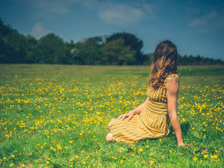 Young woman relaxing in a meadow