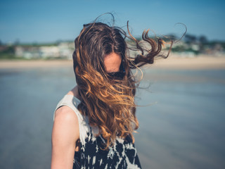 Woman on beach with wind in her hair