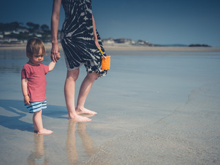 Young mother with little boy at the beach