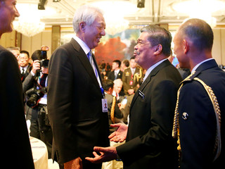 Singapore's Deputy Prime Minister and Coordinating Minister for National Security Teo Chee Hean talks to Malaysian Defence Minister Mat Sabu at the IISS Shangri-la Dialogue in Singapore