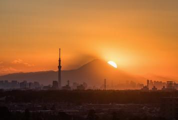 .Tokyo Fuji diamond with Tokyo Skytree landmark.  Diamond Fuji is View of the setting sun meeting the summit of Mt. Fuji
