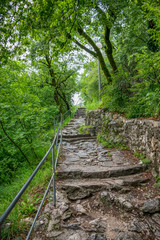 Stone steps lead to the top of the mountain to the medieval temple.