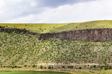 green slope of crater with Lake Nar in Cappadocia