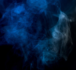 Abstract blue smoke on a dark background