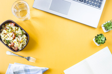 Wall Murals Assortment Vegetable salad with macaroni bowls with cheese in a container for lunch at the office workplace near the laptop. Top view, flat lay. Copyspace
