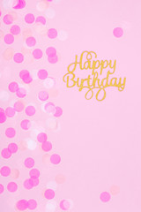 Creative pastel fantasy holiday card with cupcake and happy birthday lettering. Baby shower, birthday, celebration concept.