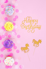 Creative pastel fantasy holiday card with cupcake, happy birthday lettering and unicorn. Baby shower, birthday, celebration concept.
